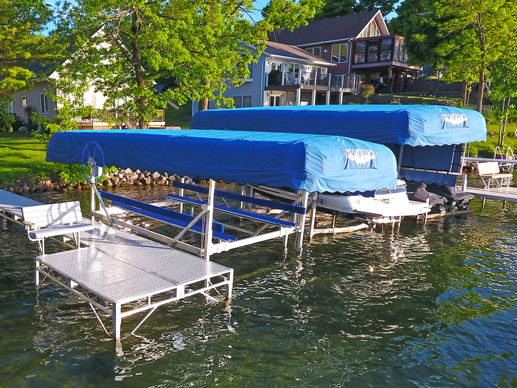 ShoreMaster Vertical Lifts with Blue Canopies and Infinity TS9 with Gray Glacier