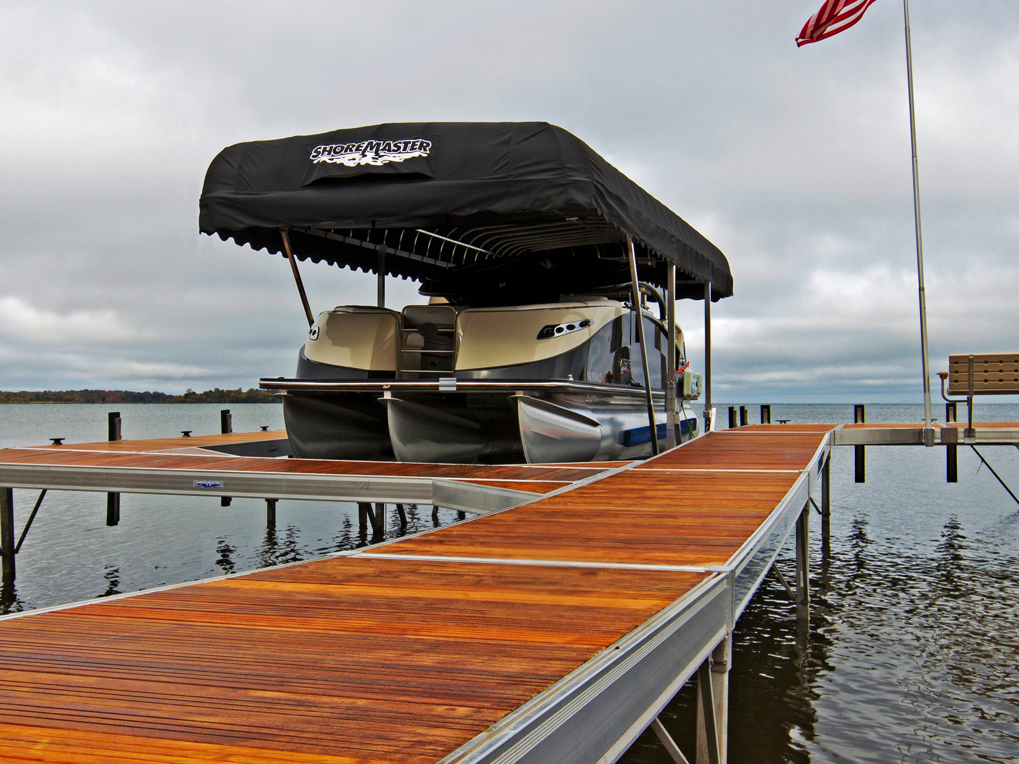 ShoreMaster RS7 Dock with IPE Decking and a Vertical Pontoon Light with Black Canopy